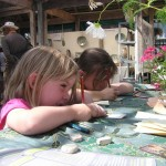 Children at Art in Action creating a Naturebook collage with Siren and Nature in Art staff, July 2011