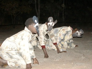 Children acting out painted dog play