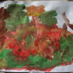 Autumn leaves, Toddler painting at Oxford Outdoor Learning Festival, 2011